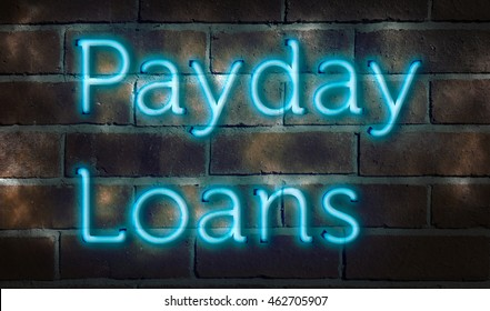 """Neon sign against brick wall """"payday loans"""""""