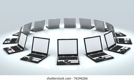 Netbook computers with blank screen stacked in circle isolated on white background