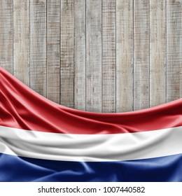 Netherlands flag of silk and wood background -3D illustration