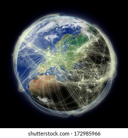 Network of flight paths over Europe on blue planet Earth isolated on black background. Highly detailed planet surface. Elements of this image furnished by NASA.