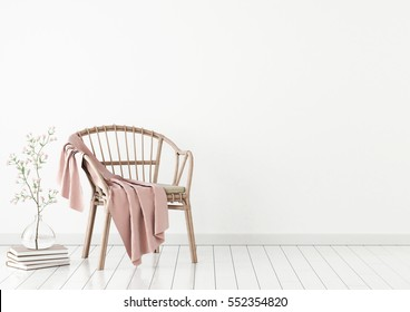 Neutral interior mockup with wicker chair, plaid and plant in vase on empty wall background. 3D rendering.