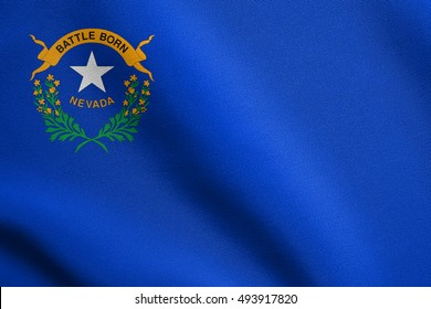 Nevadan official flag, symbol. American patriotic element. USA banner. United States of America background. Flag of the US state of Nevada waving in the wind with detailed fabric texture