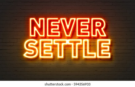 Never settle neon sign on brick wall background