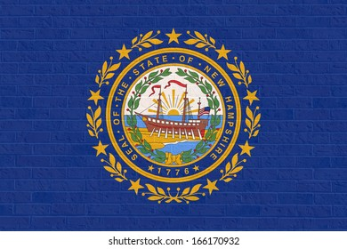 New Hampshire state flag of America on brick wall, isolated on white background.