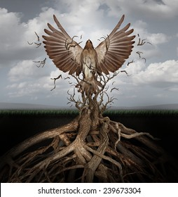 New life breaking free as a concept for freedom and power as the rise of the phoenix to be reborn and overcome challenges rising from entangled tree roots as a success symbol of hope.