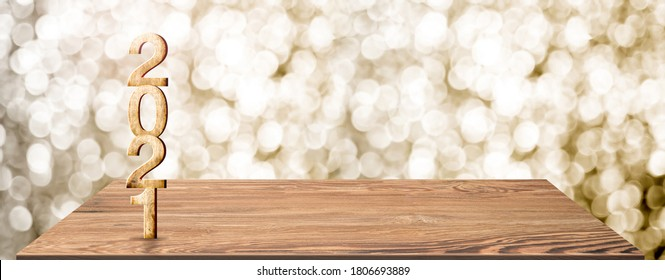 New year 2021 white wood number (3d rendering) on wooden table at blur abstract gold bokeh background,Mock up banner space for display or montage of product,holiday celebration greeting card