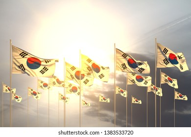 nice memorial day flag 3d illustration - many Republic of Korea (South Korea) flags in a row on sunset with empty place for text