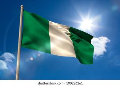 Nigeria national flag on blue sky background