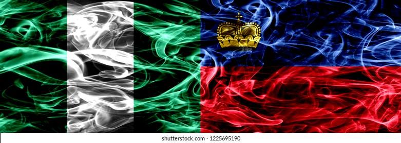 Nigeria, Nigerian vs Liechtenstein, Liechtensteins smoke flags placed side by side. Thick abstract colored silky smoke flags