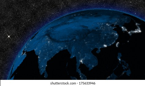 Night in East Asia region with city lights viewed from space. Elements of this image furnished by NASA.