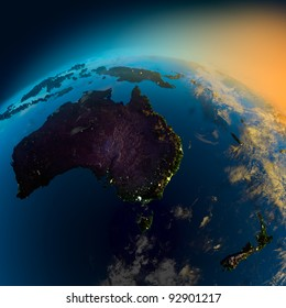 Night view of Australia from the satellite to the glowing lights of towns on the sunrise from the east