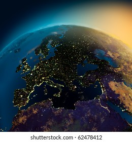 Night view of Europe from the satellite to the glowing lights of towns on the sunrise from the east