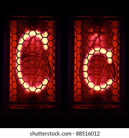 "Nixie tube indicator set of letters the whole alphabet. The letter ""C""."