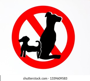 No dogs allowed sign with the silhouettes of two animals, one small and one large.