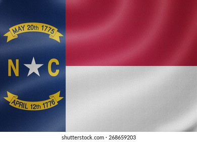 North Carolina flag on the fabric texture background