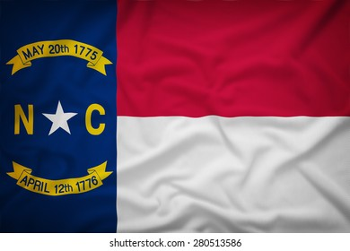 North Carolina flag on the fabric texture background,Vintage style