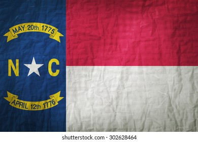 North Carolina flag painted on a Fabric creases,retro vintage style