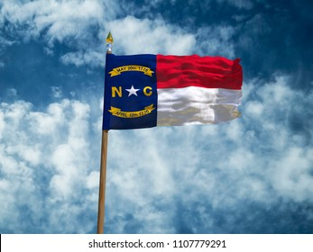 North Carolina flag USA flag Silk waving flag made transparent fabric of North Carolina US state with wooden flagpole gold spear on background blue sky white  clouds real retro photo 3d illustration