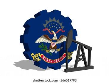 north dakota oil industry, state flag on gear and derrick model near