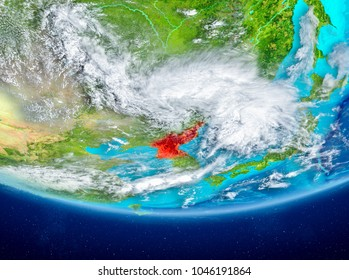 North Korea highlighted in red on planet Earth with clouds. 3D illustration. Elements of this image furnished by NASA.