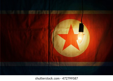 North Korean flag lit by a lamp. flag of North Korea the country with nuclear missiles. flag of North Korea the country with nuclear missiles. flag of North Korea the country with nuclear missiles