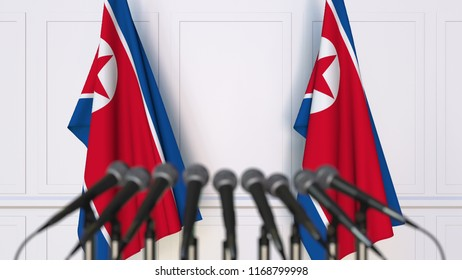 North Korean official press conference. Flags of North Korea and microphones. Conceptual 3D rendering