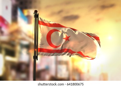 Northern Cyprus Flag Against City Blurred Background At Sunrise Backlight 3D Rendering