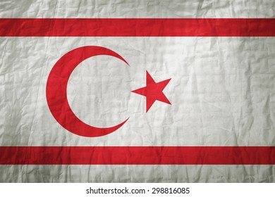 Northern Cyprus flag painted on a Fabric creases,retro vintage style