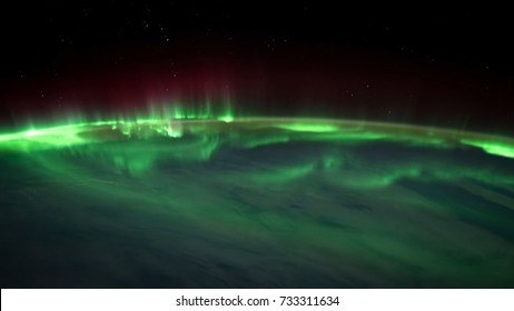 Northern lights view from space. Animation. Northern lights from the stratosphere. Northern Lights over lagoon in Iceland. Beautiful natural phenomenon Animation