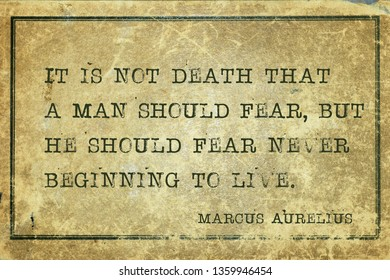 It is not death that a man should fear, but he should fear never beginning to live - ancient Roman Emperor and philosopher Marcus Aurelius quote printed on grunge vintage cardboard