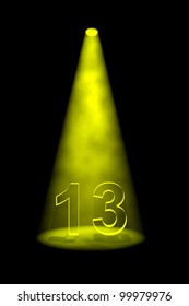 Number 13 illuminated with yellow spotlight on black background