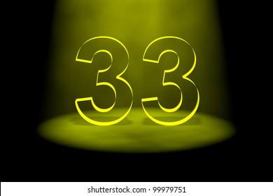 Number 33 illuminated with yellow light on black background