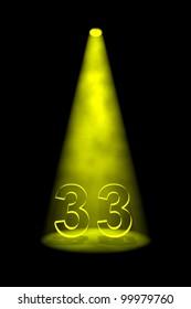 Number 33 illuminated with yellow spotlight on black background