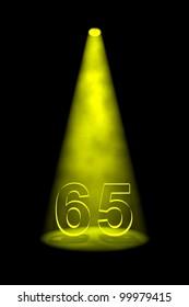 Number 65 illuminated with yellow spotlight on black background