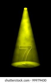 Number 7 illuminated with yellow spotlight on black background