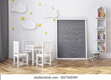Nursery interior with a wooden floor, white walls, a bed and a round table with chairs. A vertical chalkboard near the wall. A bookcase. 3d rendering mock up