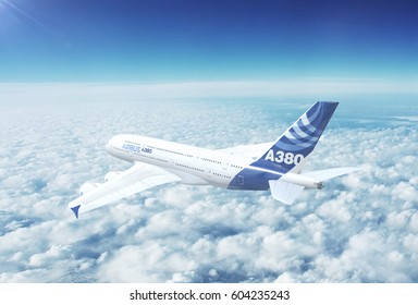 NYC, NEW YORK, UNITED STATES - CIRCA 2017: In-flight view of Airbus A380 Commercial Passenger Aircraft Flying High Up in the Sky Above the Clouds. 3D Illustration.