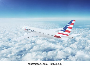 NYC, NEW YORK, UNITED STATES - CIRCA 2017: In-flight view of American Airlines Boeing 777 Commercial Passenger Aircraft Flying High Up in the Sky Above the Clouds. 3D Illustration.