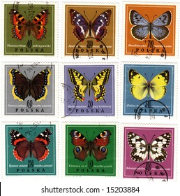 Obsolete postage stamps from Poland . Old collectible post stamps show colorful butterflies.