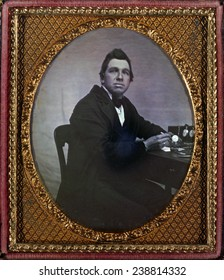 Occupational portrait of a watchmaker, seated at table with watches. sixth plate daguerreotype ca. 1840-1860