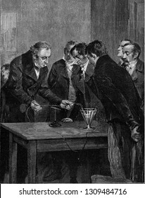 Oersted demonstrates the deviation of the magnetic needle by the electric current, vintage engraved illustration. From the Universe and Humanity, 1910.