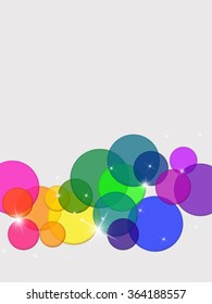 An off white background with rainbow colored circles of different sizes and a few specks of glimmering light. Colors are transparent and over lay each other. Colors include both warm and cool colors.