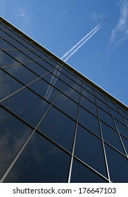 Office building with airplane and blue sky