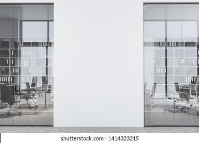 Office hall with white and glass walls, concrete floor, open space area with rows of computer desks and bookcases and mock up wall in the center. 3d rendering