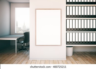 Office interior with blank frame on concrete wall, workplace and shelves. Mock up, 3D Rendering