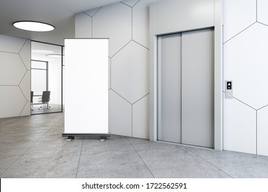 Office interior with elevator and blank vertical banner on wall. Startup and entrepreneurship concept. 3D Rendering