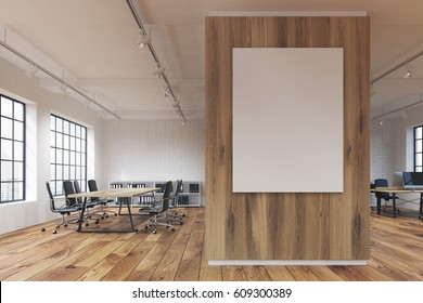 Office with a poster hanging on a wooden wall, rows of tables with computers and wooden floor. 3d rendering. Mock up