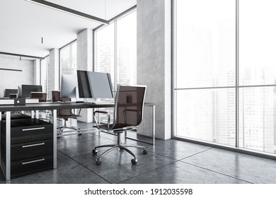 Office room with armchairs and computers on the tables near windows. Light grey office room with modern minimalist furniture, 3D rendering no people