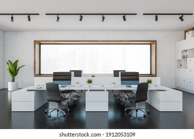 Office room with armchairs and computers on white tables near window. White and black manager room with modern minimalist furniture, 3D rendering no people
