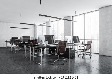 Office room with armchairs and computers on the tables near windows, side view. Light grey office room with modern minimalist furniture, 3D rendering no people